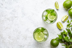 Mojito cocktail alcohol bar long drink traditional fresh tropical beverage top view copy space two highball glass. With rum, spearmint, lime juice, soda water royalty free stock photography