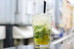 Mojito cocktail on the bar. A mojito cocktail is the perfect summer drink with its refreshing hit of mint and lime Stock Photo