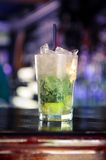 Mojito cocktail on the bar. A mojito cocktail is the perfect summer drink with its refreshing hit of mint and lime Stock Images