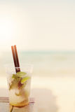 Mojito cocktail on the beach, blurred beach background. Sun, sun haze, glare Royalty Free Stock Photography