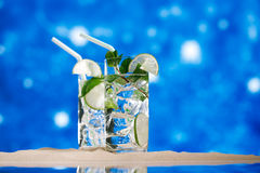Mojito cocktail on beach sand and tropical seascape Stock Image