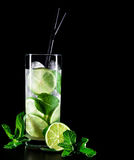 Mojito cocktail on black background with copyspace. Mojito cocktail on black background with lime and mint with copy space Stock Photography
