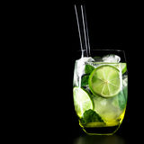 Mojito cocktail on black background with copyspace. Mojito cocktail on black background with lime and mint with copy space Royalty Free Stock Images