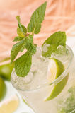 Mojito cocktail close-up with a straw hat background Stock Images