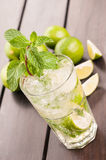 Mojito cocktail close-up on a wooden table Royalty Free Stock Photos