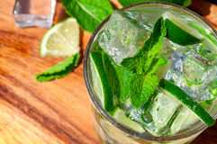 Mojito cocktail. Cold refreshing cocktail with mint and lime and ice cubes Stock Photography