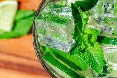 Mojito cocktail. Cold refreshing cocktail with mint and lime and ice cubes Stock Images