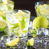 Mojito cocktail on a dark background with lime and ice Royalty Free Stock Photos
