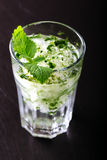 Mojito cocktail on a dark. Rustic table Stock Photography