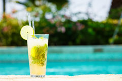 Mojito cocktail at the edge of a resort pool.  Concept of luxury Stock Photo