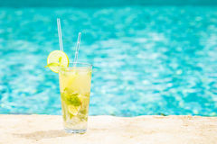 Mojito cocktail at the edge of a resort pool.  Concept of luxury Stock Images