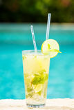 Mojito cocktail at the edge of a resort pool.  Concept of luxury Stock Image