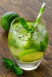 Mojito cocktail and fresh ingredients on brown Stock Image