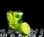 Mojito cocktail with fresh limes Royalty Free Stock Photography