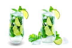 Mojito cocktail with fresh mint leaves and lime slice isolated stock photo