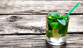Mojito cocktail . Freshly made mojito in glass with mint, lime and rum. Stock Photo