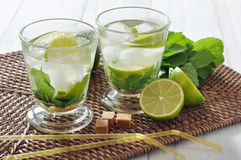 Mojito cocktail. In glass with lime and mint on wicker place mat Royalty Free Stock Photos