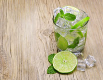 Mojito cocktail in glass with mint on old wood background Stock Photo