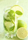 Mojito cocktail on green background Stock Photos
