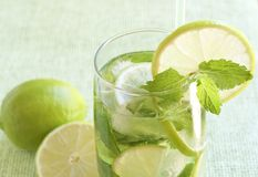 Mojito cocktail on green background Royalty Free Stock Image