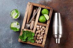 Mojito cocktail ingredients box. Mojito cocktail ingredients and bar accessories box. Top view Royalty Free Stock Image