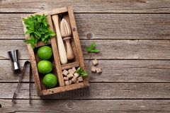 Mojito cocktail ingredients box. Mojito cocktail ingredients and bar accessories box on wooden table. Top view with copy space stock photo