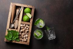 Mojito cocktail ingredients box. Mojito cocktail ingredients and bar accessories box. Top view with copy space Royalty Free Stock Images