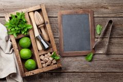 Mojito cocktail ingredients box. Mojito cocktail ingredients and bar accessories box on wooden table. Top view with copy space Royalty Free Stock Photos