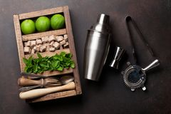 Mojito cocktail ingredients box. Mojito cocktail ingredients and bar accessories box on stone table. Top view Royalty Free Stock Images