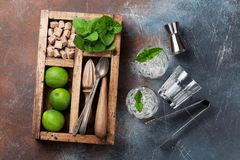 Mojito cocktail ingredients box. Mojito cocktail ingredients and bar accessories box. Top view royalty free stock images