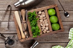 Mojito cocktail ingredients box. Mojito cocktail ingredients and bar accessories box on wooden table. Top view Stock Photography
