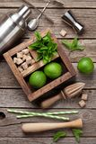 Mojito cocktail ingredients box. Mojito cocktail ingredients and bar accessories box on wooden table. Top view Royalty Free Stock Photo