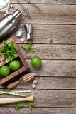 Mojito cocktail ingredients box. Mojito cocktail ingredients and bar accessories box on wooden table. Top view with copy space royalty free stock image