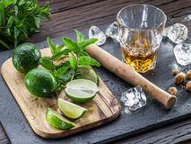 Mojito cocktail ingredients. Mojito cocktail ingredients on the wooden table Royalty Free Stock Photography