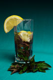Mojito cocktail with lemon and mint on blue background Stock Images