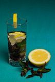 Mojito cocktail with lemon and mint on blue background Stock Photos
