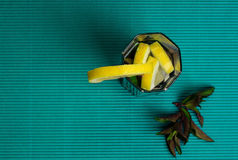 Mojito cocktail with lemon and mint on blue background Royalty Free Stock Photos