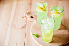 Mojito cocktail or lemonade with lime, mint and ice cubes. Traditional summer refreshing drink. Stock Photo