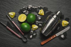 Mojito cocktail with lime and mint in glass on a grey stone back Stock Images