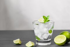 Mojito cocktail with lime and mint in glass on a grey stone back Royalty Free Stock Image