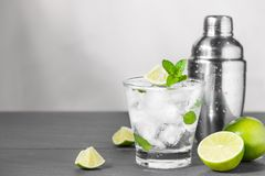 Mojito cocktail with lime and mint in glass on a grey stone back Stock Photography