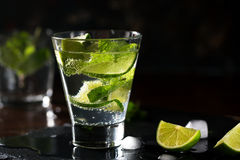 Mojito cocktail with lime and mint. Low key photo Stock Photos