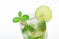 Mojito cocktail with lime and mint in tumbler glass Stock Photography