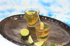 Mojito cocktail with lime and mints Stock Photography