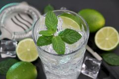 Mojito cocktail on dark stone table royalty free stock photography