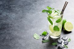 Mojito cocktail. On dark stone table. With copy space for your text royalty free stock images