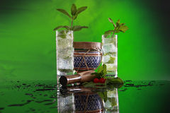 Mojito cocktail, muddler and bongo. Cuban tradition muddled mint cocktail with a splash of soda Royalty Free Stock Photos