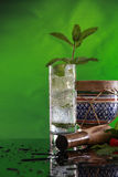 Mojito cocktail, muddler and bongo Royalty Free Stock Photo
