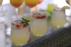 Mojito cocktail with pomegranate, mint, lemon juice and ice. stock photo