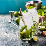Mojito cocktail on rustic background Stock Photos